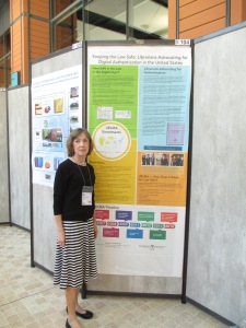 Sally Holterhoff and her poster on authentication and advocacy by law librarians in the United States.